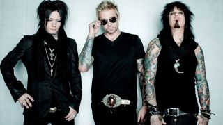 DJ Ashba, James Michael and Nikki Sixx