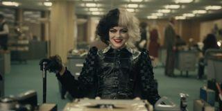 Cruella de Vil relishing in her madcap behavior as she is being interviewed by Anita Darling in Cruella