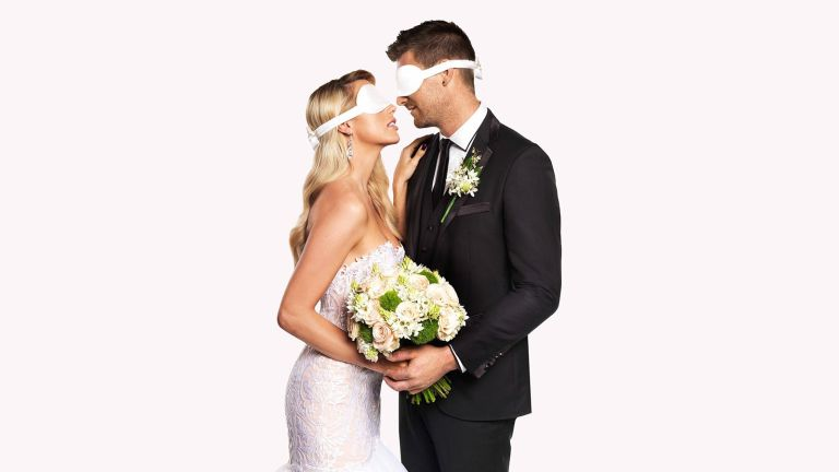 An image promoting watch Married At First Sight Australia with a blindfolded bride and groom