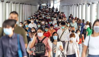 People wearing face masks in a Bangkok transportation hub in March 2020.