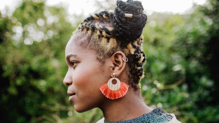 Side profile of woman wearing earrings