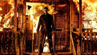 Michael Myers in front of a burning house in Halloween Kills