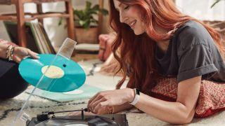 Woman wearing Fitbit Luxe