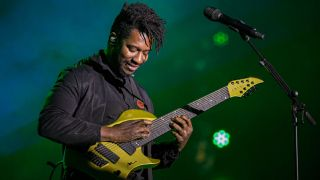 Guitarist Tosin Abasi of Animals as Leaders performs on stage at The NAMM Show 2020 Day 1 at Anaheim Convention Center on January 16, 2020 in Anaheim, California.