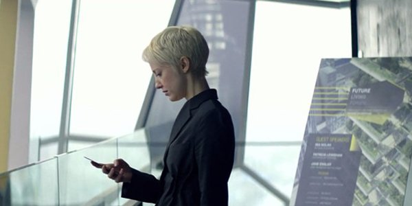 Netflix Black Mirror Crocodile Andrea Riseborough plays architect Mia Nolan looking at her phone