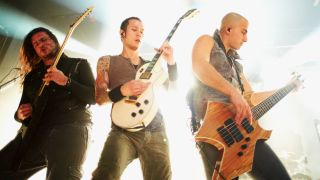 Corey Beaulieu, Matt Heafy and Paolo Gregoletto of Trivium perform on stage at Manchester Academy on December 3, 2011