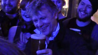 A picture of Bruce Dickinson serving beer in Wales
