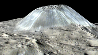 New work suggests that dwarf planet Ceres' biggest mountain, Ahuna Mons, may have formed after a muddy slurry erupted. This image shows a side view of Ahuna Mons, which is 2.5 miles tall and 10.5 miles wide (4 by 17 kilometers). Ahuna Mons has a dome shape that resembles that of mountains created on Earth by volcanism. However, unlike volcanoes on Earth, Ahuna Mons was created by a volcano spewing cold, molten ice rather than hot, liquid rock.