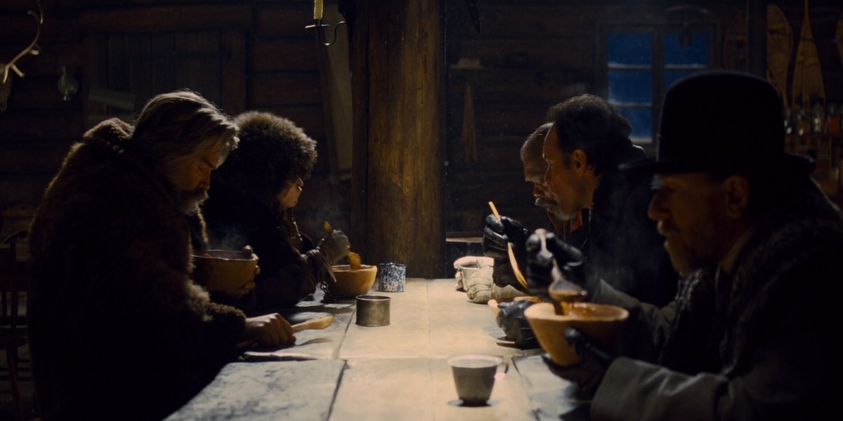 The Hateful Eight eating stew together