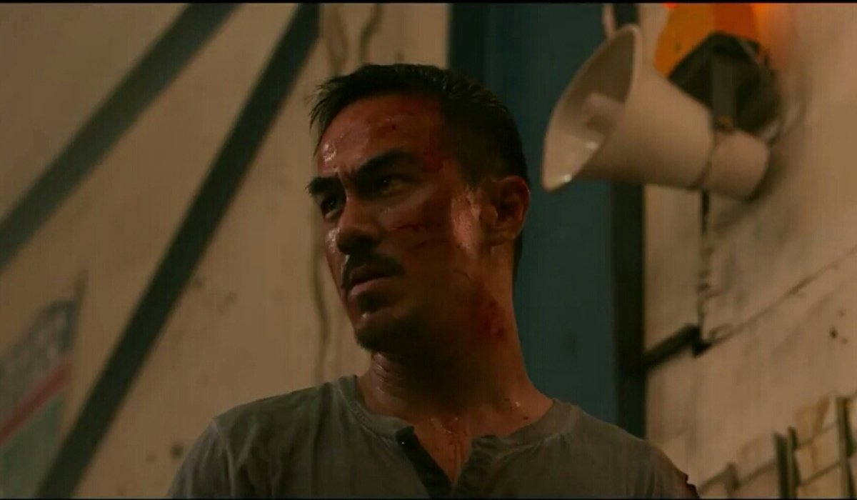 The Night Comes For Us Joe Taslim bloody and sweaty in a warehouse