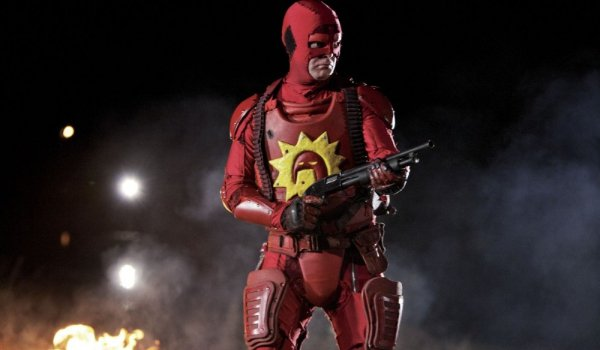 Super The Crimson Bold stands tall with a shotgun in hand