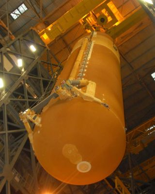 NASA Attaches Rocket Boosters to Repaired Shuttle Fuel Tank