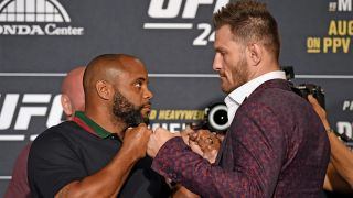 AUGUST 15: (L-R) Daniel Cormier and Stipe Miocic face off during the UFC 241 Ultimate Media Day at the Hilton Anaheim hotel on August 15, 2019 in Anaheim, California.