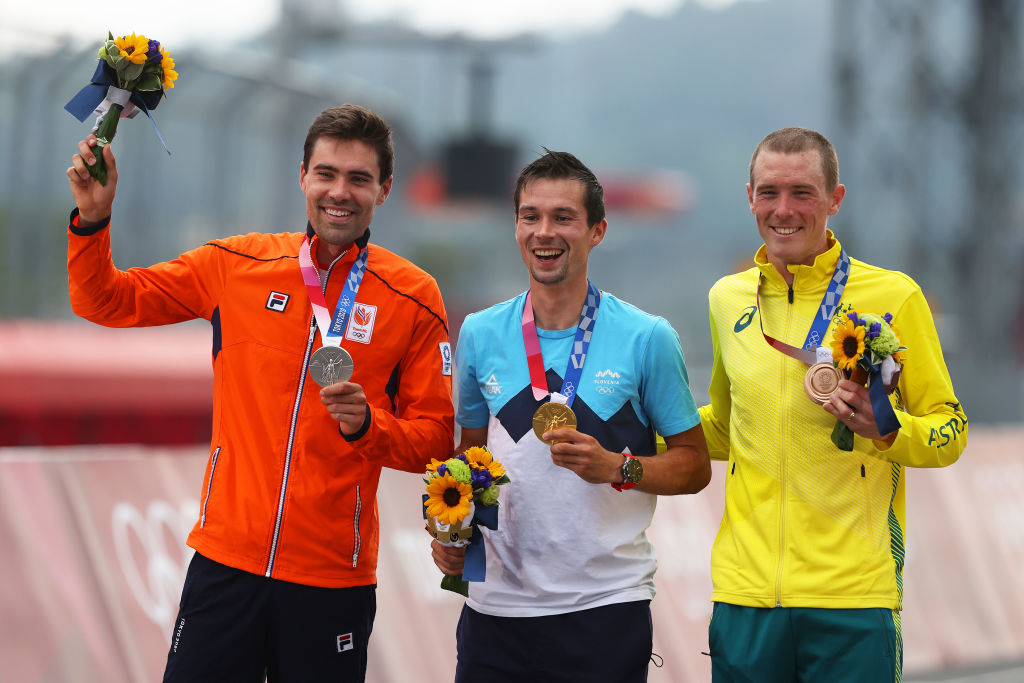 OYAMA JAPAN JULY 28 LR Silver medalist Tom Dumoulin of Team Netherlands gold medalist Primoz Roglic of Team Slovenia and bronze medalist Rohan Dennis of Team Australia pose on the podium during the medal ceremony after the Mens Individual time trial on day five of the Tokyo 2020 Olympic Games at Fuji International Speedway on July 28 2021 in Oyama Shizuoka Japan Photo by Michael SteeleGetty Images