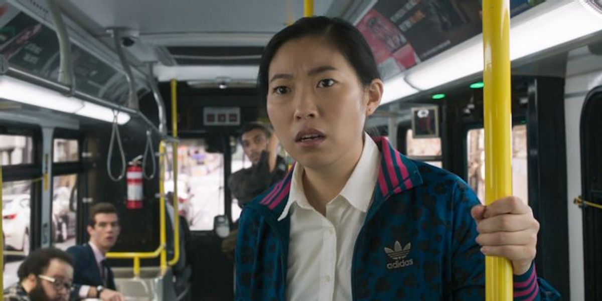 Awkwafina as Katy in bus scene in Shang-Chi and the Legend of the Ten Rings