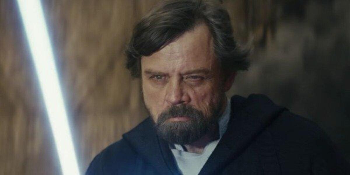 Luke Skywalker (Mark Hamill) wields his lightsaber in Star Wars: The Last Jedi (2017)