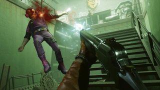 Deathloop shooting an enemy with a shotgun