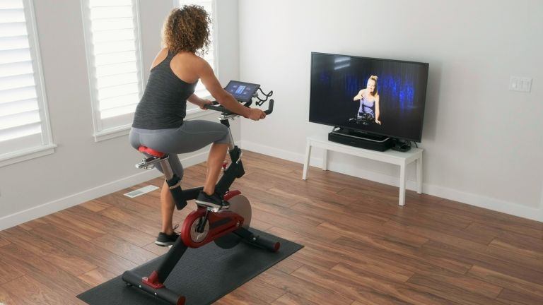 woman on one of the best exercise bikes