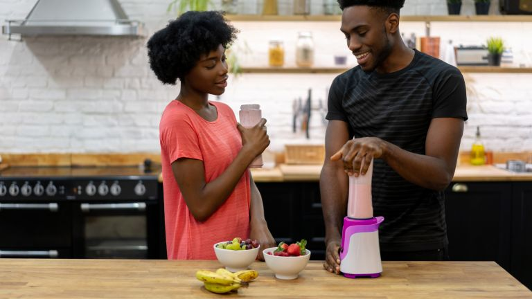Woman and man drinking a shake made from the best protein powder for weight loss