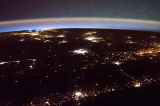 Lightning And 'Probably Satellites' Seen From Space Station | Video