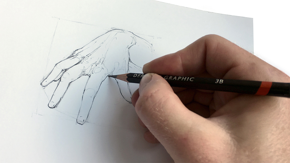 Hand holding a pencil that is sketching a picture of a hand