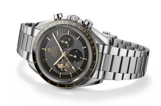 "Two Apollo 11 tributes are found on the dial of the Speedmaster Apollo 11 50th Anniversary Limited Edition. A number ""11"" features in 18K Moonshine Gold at 11 o'clock. More notably, the 9 o'clock subdial shows Buzz Aldrin climbing down to the surface."