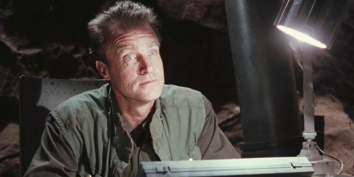 Total Recall Marshall Bell sits at a desk on Mars