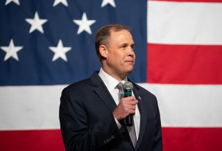 In this October 2019 photo, NASA chief Jim Bridenstine helps unveil two spacesuits the agency is designing for its Artemis moon program.