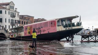 A water taxi sits moored in a Venetian courtyard following the second-highest tide in the city's history.