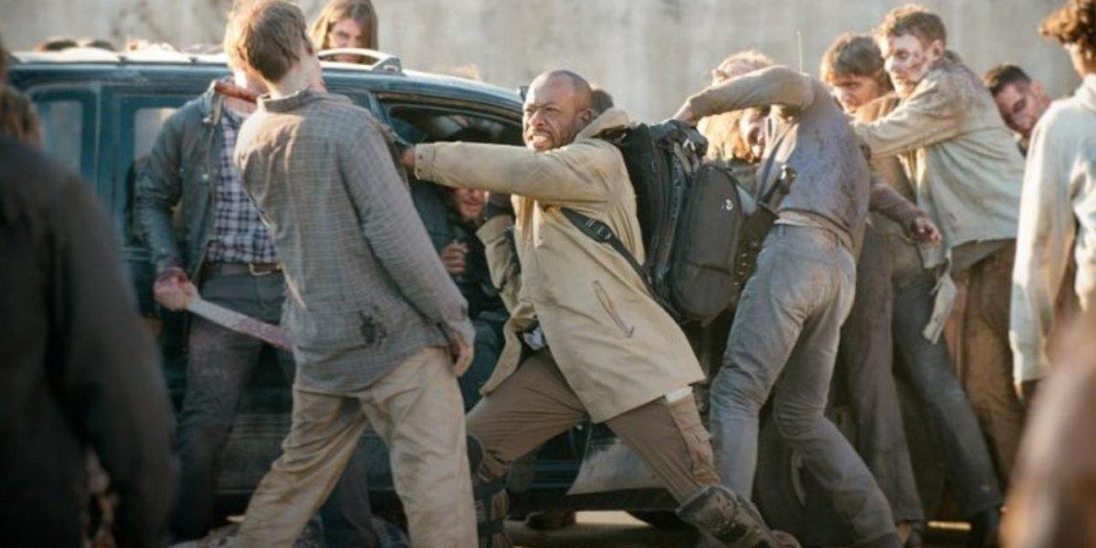 Morgan fighting walkers in The Walking Dead.