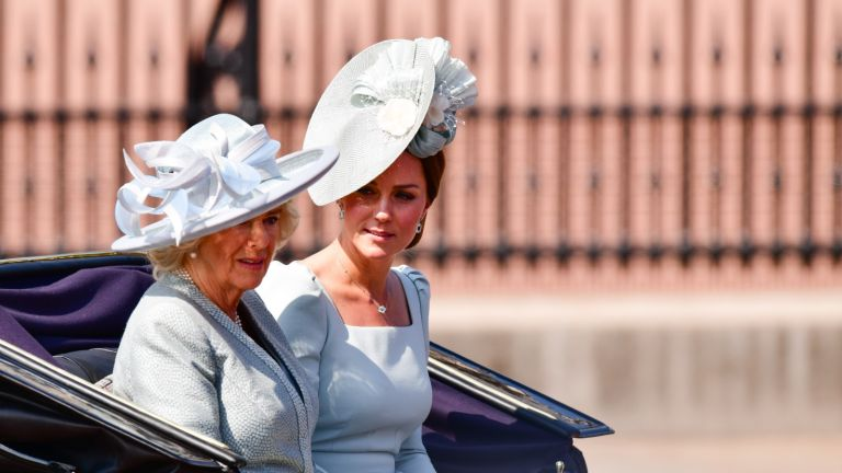 Kate middleton and Camilla riding in carriage