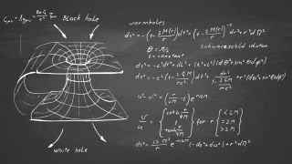 Equations that define black holes and wormholes written on a chalkboard.