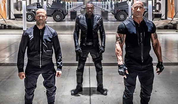 Fast & Furious Presents: Hobbs And Shaw Hobbs, Brixton, and Shaw stand at attention in front of the