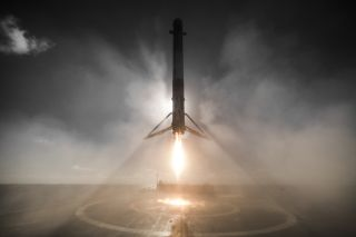 "A SpaceX Falcon 9 rocket is seen just before landing on the drone ship ""Just Read the Instructions"" in the Pacific Ocean in this spectacular photo captured on Jan. 14, 2017 just after the rocket launched 10 Iridium NEXT satellites into orbit."
