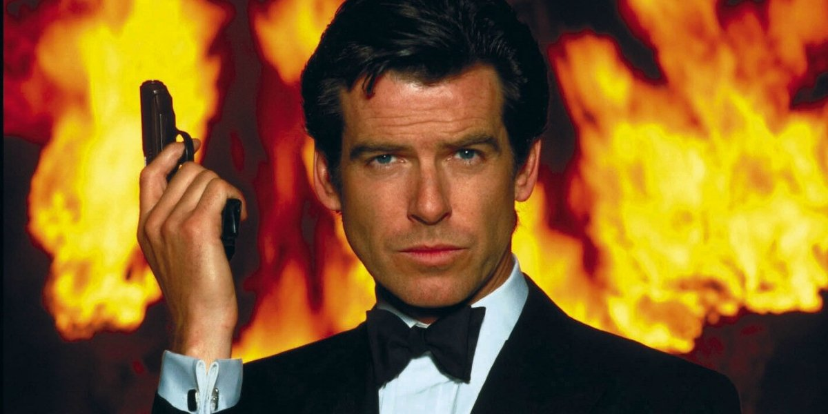 Goldeneye Pierce Brosnan holding a gun, in front of a fiery background