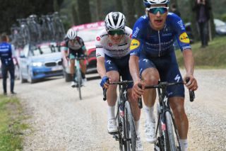 Remco Evenepoel and Joao Almeida (Deceuninck-QuickStep) chase on the dirt roads