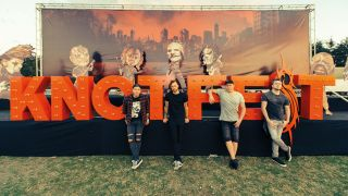 a shot of bullet for my valentine in front of the knotfest sign