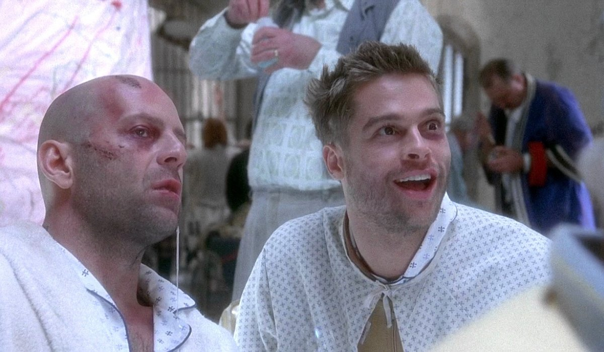 12 Monkeys Bruce Willis sits next to a manic Brad Pitt