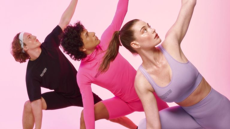 Pangaia is a sustainable brand, this image is from their latest campaign which is all about activewear, three models are pictured stretching in colorful trendy pangaia clothing