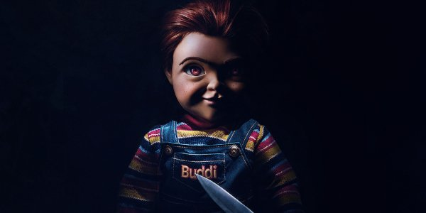 Child's Play Poster Chucky standing with a knife in the dark