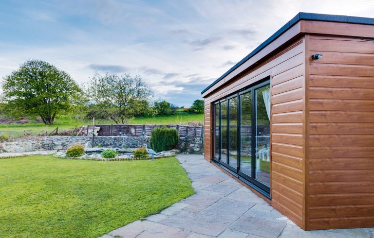 Building an annexe: a room clad in cedar wood