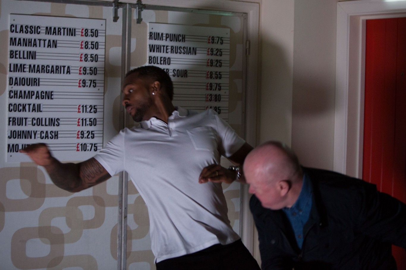 Phil Mitchell punches Vincent Hubbard in EastEnders
