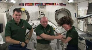 NASA astronaut Cady Coleman playing the flute on the International Space Station Feb. 9, 2011.