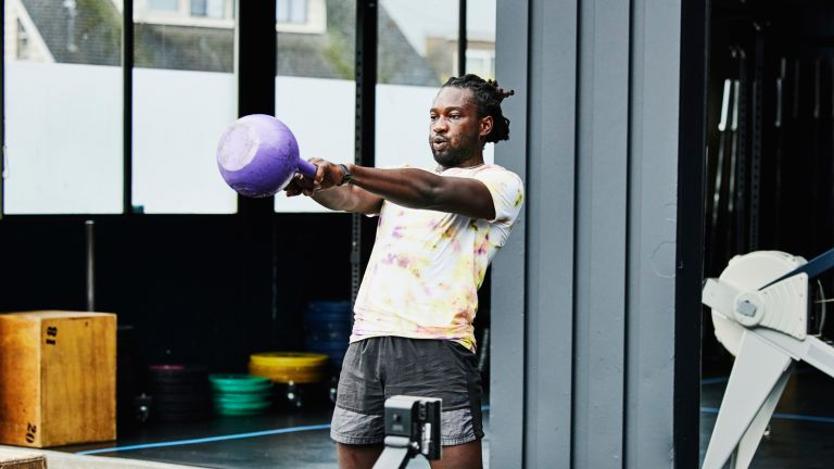 Man doing HIIT workouts with a kettlebell