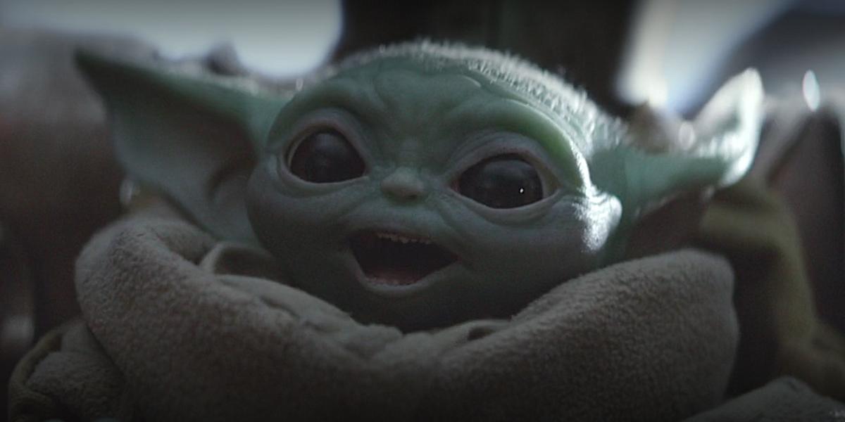 the mandalorian baby yoda smiling