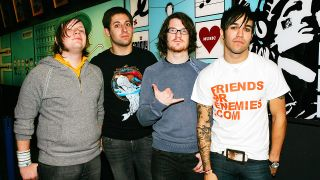 Pete Wentz, Patrick Stump, Joseph Trohman, and Andrew Hurley of Fall Out Boy pose for a photo backstage during MTV's Total Request Live