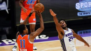 Sacramento Kings player Buddy Hield defends against a shot by the Oklahoma City Thunder's Theo Maledon during the game at Golden 1 Center on May 9, 2021 in Sacramento, California.