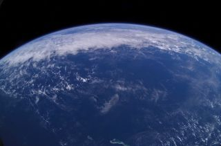This view of Earth's horizon was taken by an Expedition 7 crewmember onboard the International Space Station on June 13, 2003.