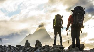 right to roam: two hikers and impressive mountain