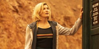 Jodie Whittaker puts her hand on the side of the TARDIS in Doctor Who.